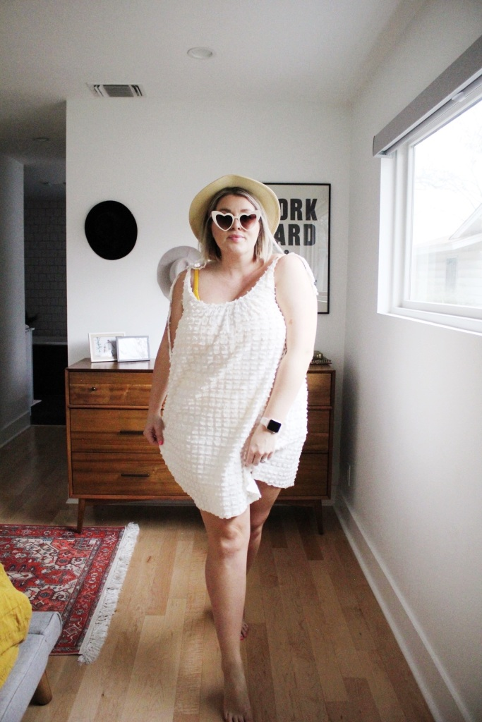 Straw hat with white dress as cover up